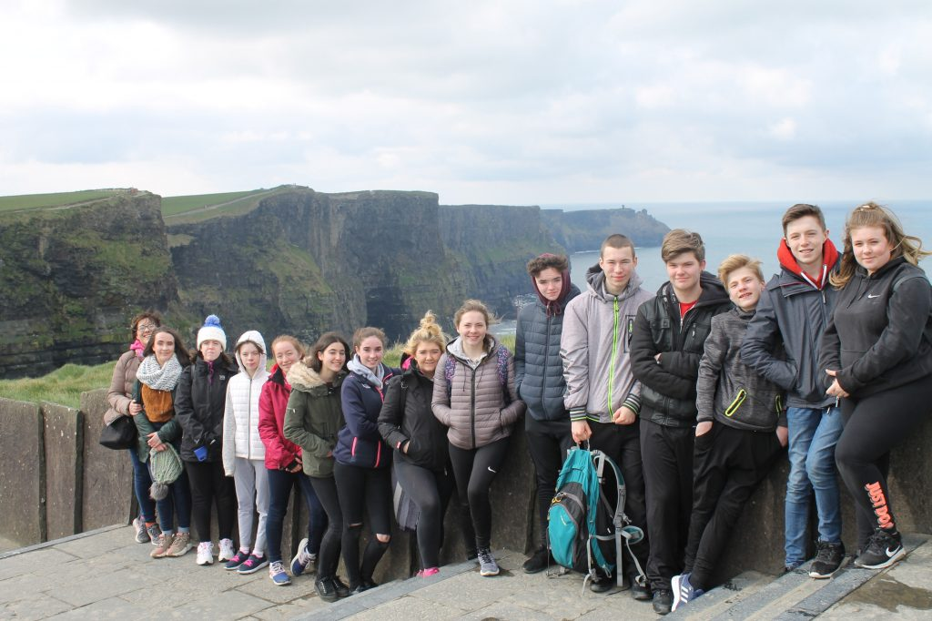 Students by the cliffs of Moher